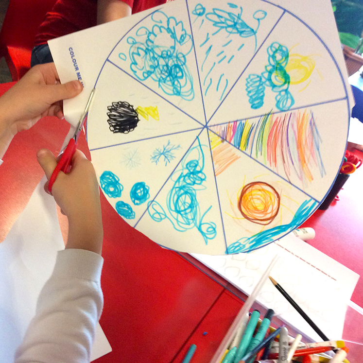 Young person cutting out their weather wheel